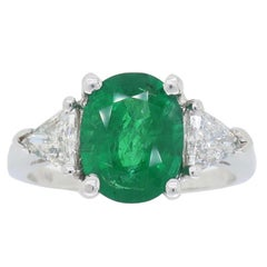 18 Karat White Gold Diamond and Emerald Three-Stone Ring