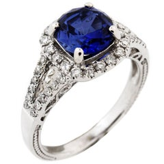White Gold and Diamond Ring with Round Tanzanite Center