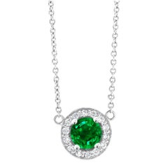 White Gold Halo Emerald and Diamond Pendant Necklace