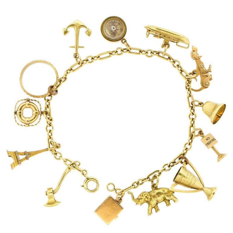 1940s 14 Karat Yellow Gold Whimsical Charm Bracelet