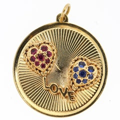 Dankner & Sons Vintage 14 Karat Gold Love Charm with Sapphire and Ruby Hearts
