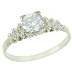 Solitaire Diamond Ring with Metal Ovals, 18 Karat White Gold