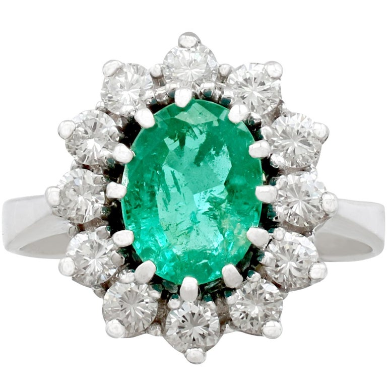 1970s 1.50 Carat Emerald and 1.12 Carat Diamond Gold Cluster Ring