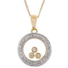 9 Carat Yellow and White Gold Floating Diamond Pendant
