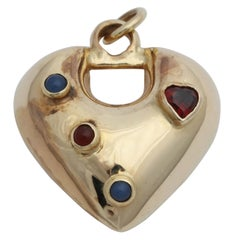 1980s Puffy Heart Blue Chalcedony with Garnet Gold Charm Pendant with Gold Bail