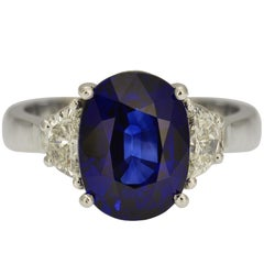 GIA Certified 5.93 Carat Royal Blue Oval Sapphire and Diamond Cocktail Ring