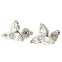 Cluster Pear Shape Diamond Earrings Weighing 2.56 Total Carat Weight in Platinum