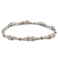 "1.20 Carat Diamond and Emerald 18 Karat White Gold ""X"" Link Bracelet"