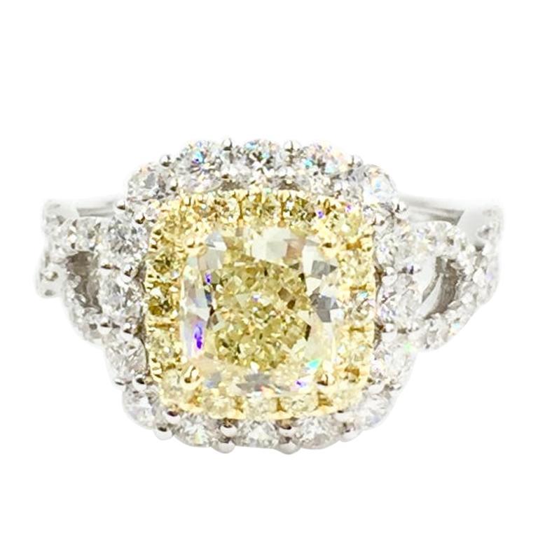 GIA Certified 1.55 Carat Natural Fancy Yellow Diamond Halo Ring