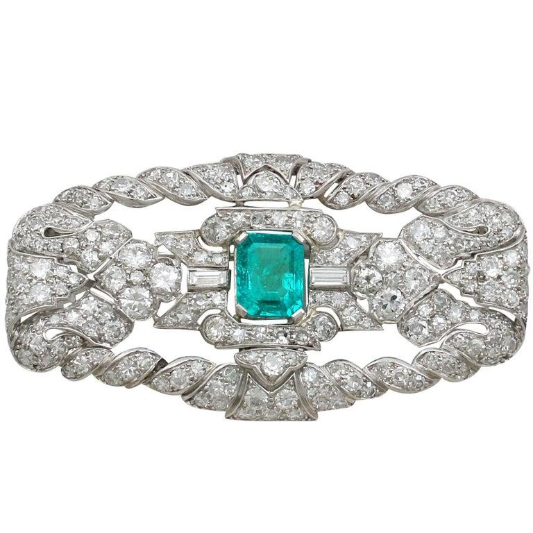 1930s Antique 1.98 Carat Emerald & 5.22 Carat Diamond Platinum Brooch