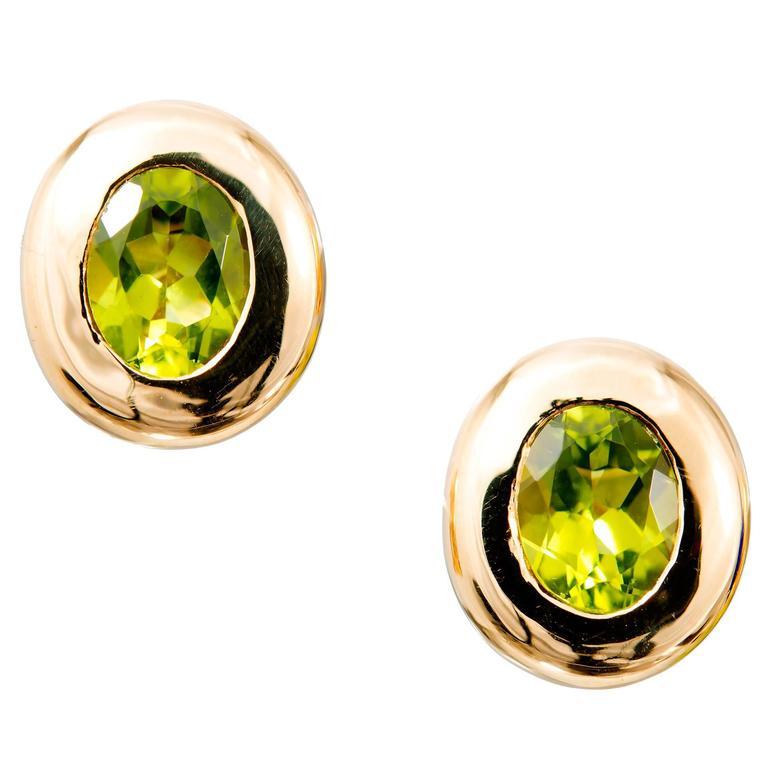 4.10 Carat Oval Green Peridot Domed Gold Bezel Stud Earrings For Sale