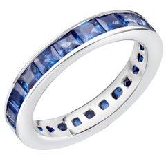 18 Karat White Gold Princess Cut Sapphire Eternity Band Weighing 4.60 Carat