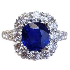 18 Karat White Gold Cushion Cut Sapphire and Diamond Ring