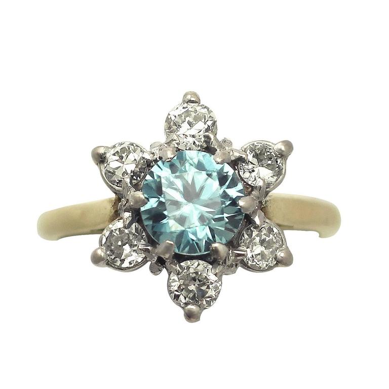 1920s Antique 1.18 Carat Blue Zircon and Diamond Yellow Gold Cluster Ring