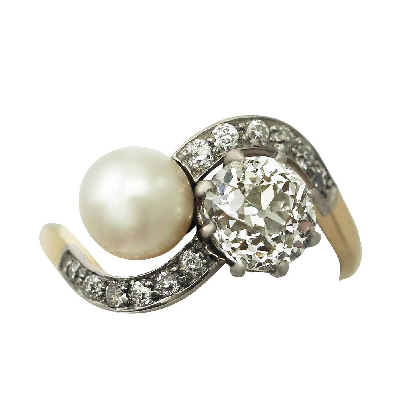 1 49 ct and pearl 18 ct yellow gold twist ring