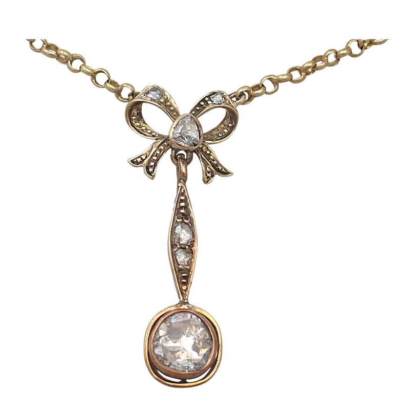 1.15Ct Diamond, 14k Yellow Gold Bow Pendant - Antique French Circa 1910