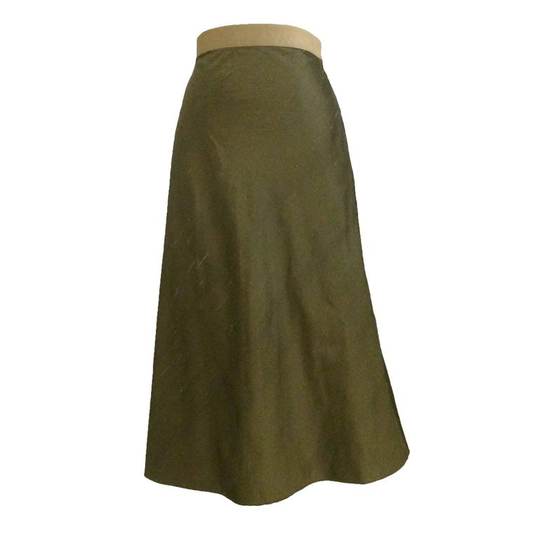 green silk a line midi skirt with gold zip detail