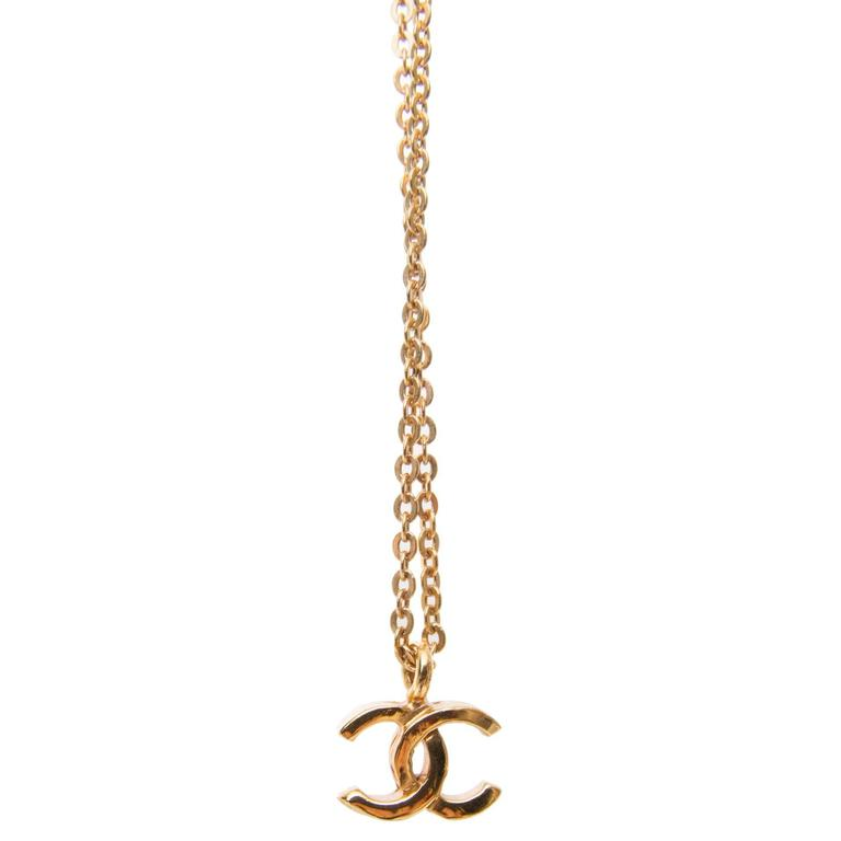 3cea616a714bf 1982 Chanel Thin Gold Chain Necklace W. Logo Pendant at 1stdibs