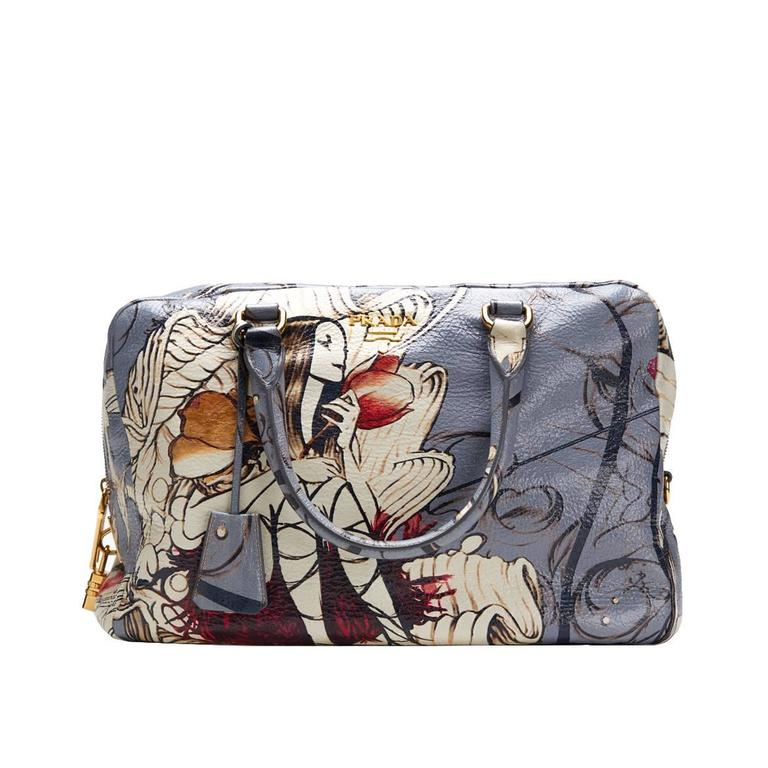 5915eef3c337 This ladies Prada Limited Edition James Jean Fairy Bag is primarily made  from multi deerskin complimented