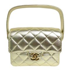 Chanel Gold Metallic Lambskin Quilted Mini Flap Handbag