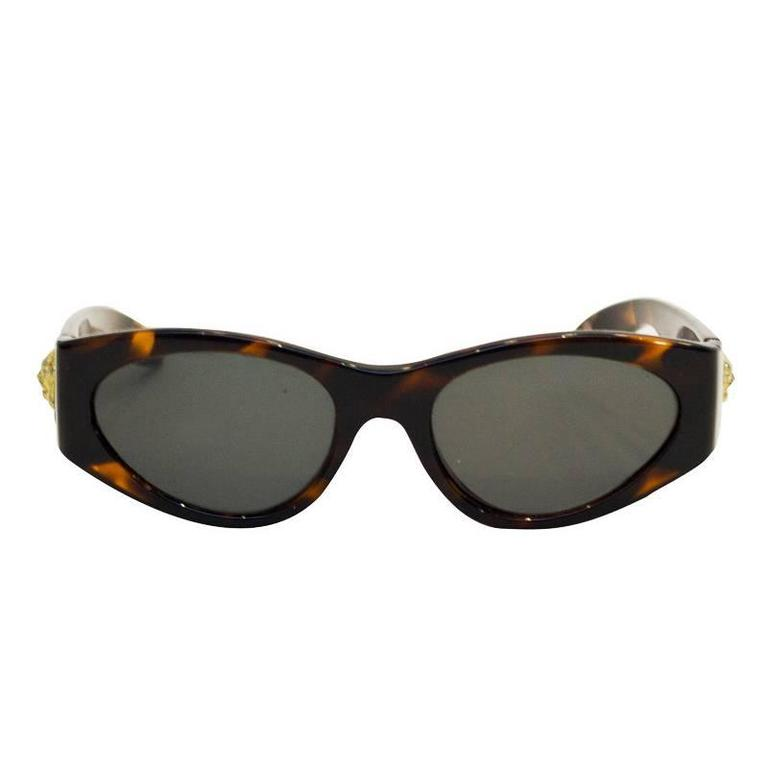 6eb8d574abf8 1980 s Versace Faux Tortoise Sunglasses with Medallions at 1stdibs