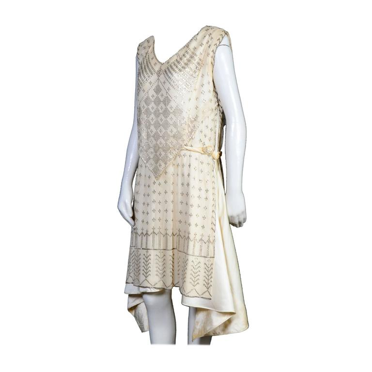"Authentic 1920's Art Deco Era Assuit dress, a rare example in cream cotton netting mesh with hand-applied spangles. Under layer soi sauvage and velvet. Although there are no tags, I am quite sure that this would have originally had the ""Made in"