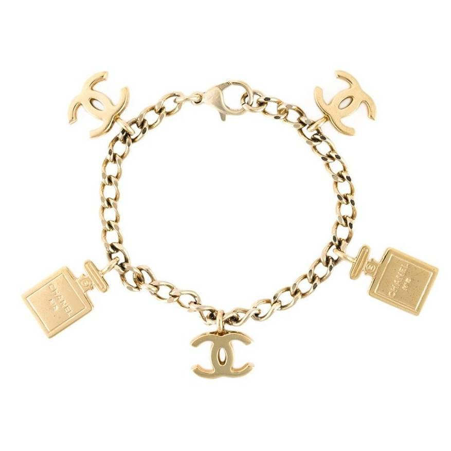 chanel n 186 5 bottle and logo charm bracelet at 1stdibs