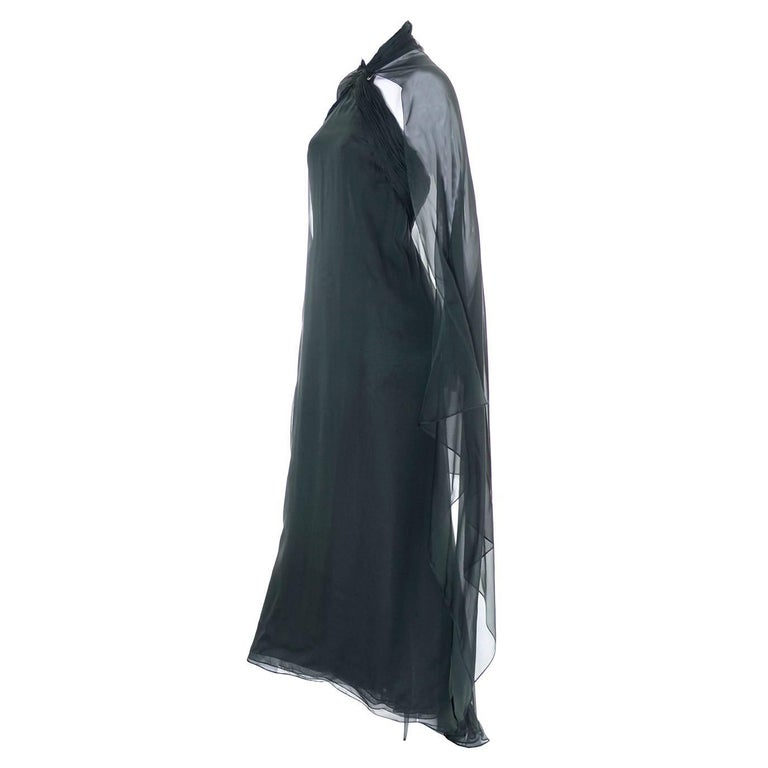 This beautiful vintage dress was designed by Oscar de la Renta in the 1990's and was sold at Saks Fifth Avenue.  This deep green silk chiffon dress has an empire waist and an attached, flowing cape that can be worn as a cape or just left to drape