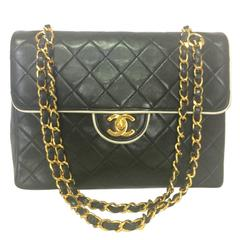 Vintage Chanel black and white lambskin 2.55 shoulder bag with golden chains