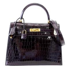 Hermes Kelly 25 Sellier Bag Crocodile Prunoir Gold Hardware Deep Plum Purple