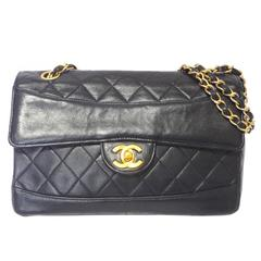 Vintage Chanel classic 2.55 black lambskin shoulder bag with golden chain straps