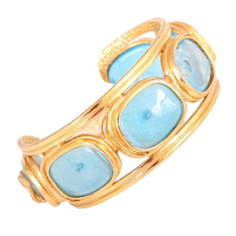 """Rare vintage 1996 Chanel gold tone cuff with aqua blue glass gripoix """"stones."""" In excellent condition. Approx. 6 1/2"""" circumference."""