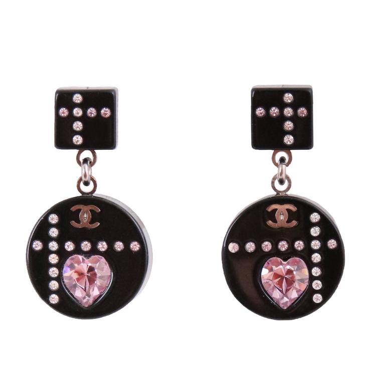 The cutest 2004A Chanel black resin pierced dangling earrings made of micro-crystals, a pink crystal heart and featuring a mini CC logo - arranged in a graphic pattern. In excellent condition. MEASUREMENTS: Overall Length - (approx.) 1 1/8