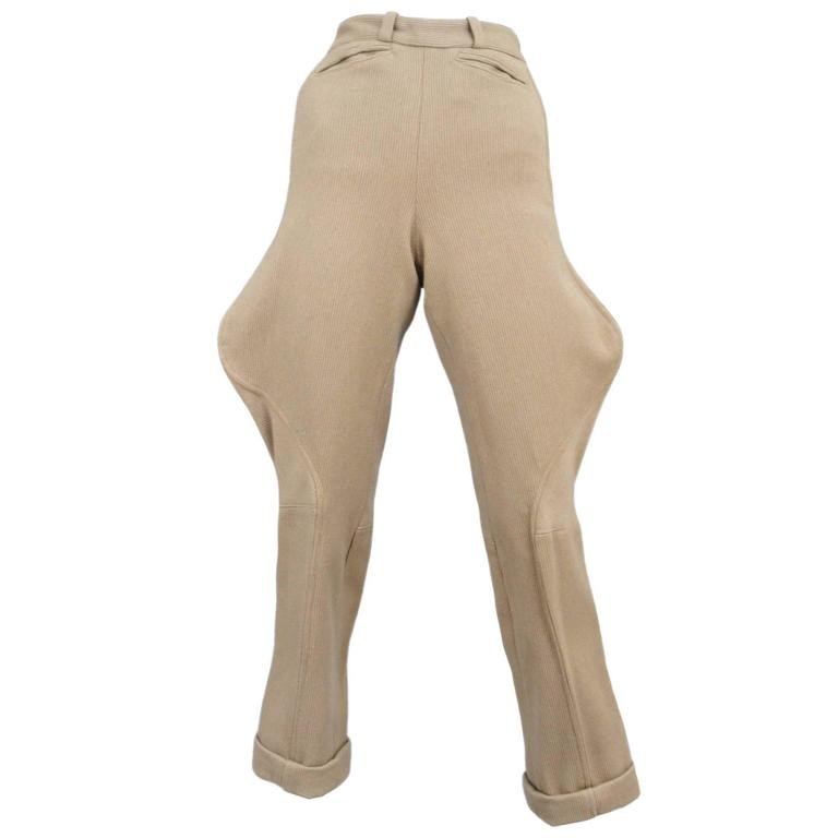 Vintage Chanel taupe ribbed wool jodhpurs featuring front welt pockets and brass studs at the back calfs.  Please contact us for additional photos.