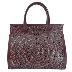 Alaia Burgundy Grommet Doctor Bag