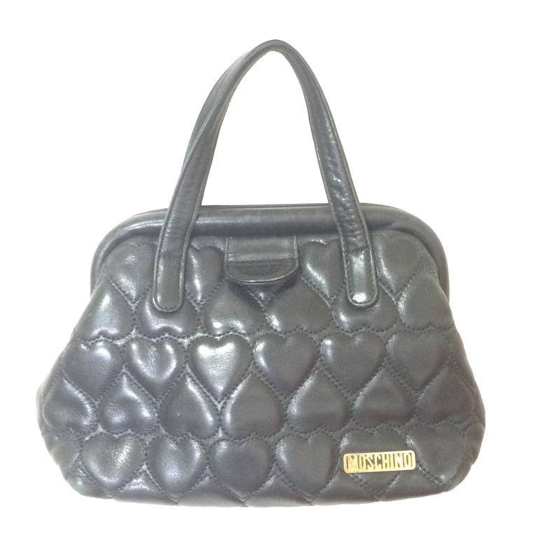 Vintage MOSCHINO black heart shape quilted lambskin mini handbag, tote purse.