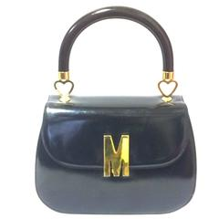 Vintage MOSCHINO black patent enamel Kelly style handbag with M logo and heart
