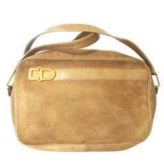 Vintage Christian Dior brown beige suede shoulder bag with golden CD motif.