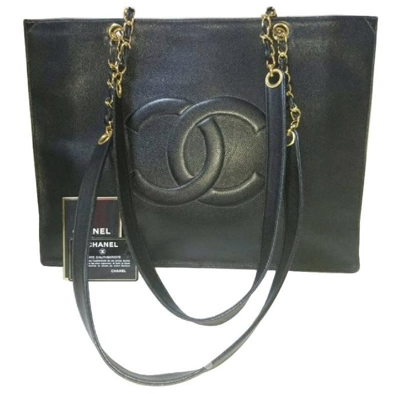 Vintage CHANEL black caviar extra large tote bag with gold tone chain straps.