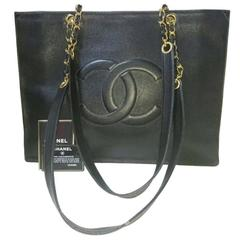 97603d697552d2 Vintage CHANEL black caviar extra large tote bag with gold tone chain  straps.