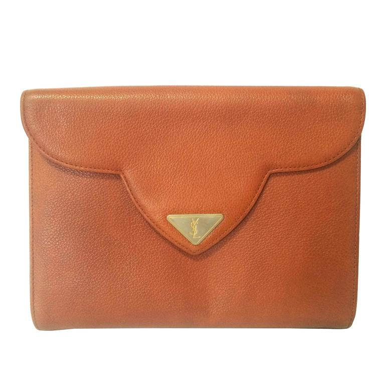 Vintage Yves Saint Laurent genuine brown leather clutch purse with beak tip flap 1