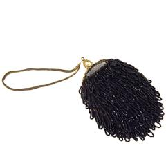 1890s Victorian Black Beaded Pouch with Filigree Frame and Carved Detail