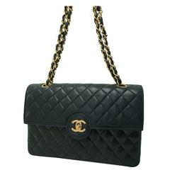 80s. Vintage Chanel rare 2.55 classic black bag with round and golden CC closure