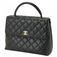 Vintage CHANEL black caviar leather kelly handbag with golden CC closure.