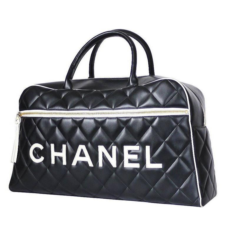 7407156a15505e Vintage Chanel Black Leather Letter Logo Jumbo Bowling Bag at 1stdibs