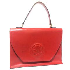 Vintage FENDI genuine red leather classic handbag with embossed Janus medallion.