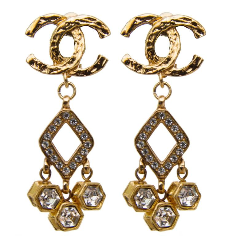 A Pair of 1980s Chanel Gold Toned Dangle Earrings W. Rhine Stone Embellishment 1