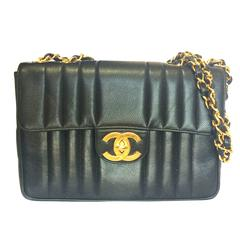 Vintage CHANEL black 2.55 jumbo caviar large shoulder bag, vertical stitches.