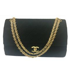 Vintage Chanel classic black jersey 2.55 bag with double flap and skinny chains