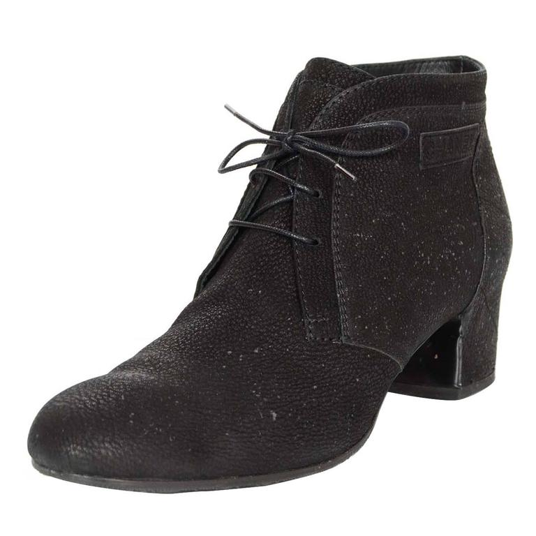 Chanel Black Suede Ankle Boots Sz 42 Features quilting at heels  Made In: Italy Color: Black Materials: Suede Closure/Opening: Lace tie closure Retail Price: $1,175 + tax Overall Condition: Excellent pre-owned condition with the exception of